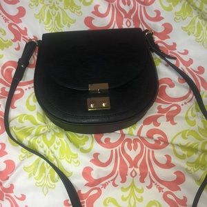 Express sling over purse